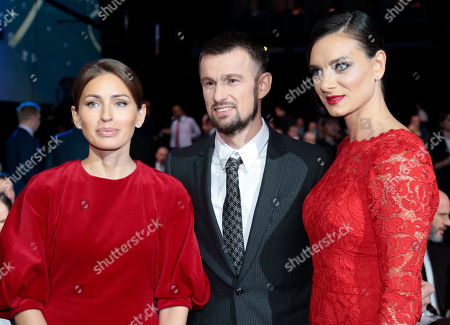 Former Russian soccer player Sergei Semak, center, poses for a photograph with his wife Anna, left, and former Russian pole vaulter Yelena Isinbayeva prior to the draw for the soccer Confederations Cup 2017, in Kazan, Russia, . The tournament will be played June 17 trough July 2, 2017 in four Russian cities