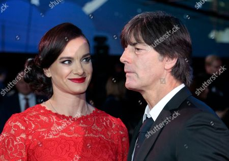 Former Russian pole vaulter Yelena Isinbayeva, left, looks to Germany's head coach Joachim Loew prior to the draw for the soccer Confederations Cup 2017, in Kazan, Russia, . The tournament will be played June 17 trough July 2, 2017 in four Russian cities