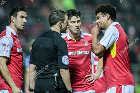 The Rotherham United players talk to Stuart Attwell (referee) to find out why Peter Odemwingie (Rotherham United) received a straight red card during the EFL Sky Bet Championship match between Rotherham United and Leeds United at the New York Stadium, Rotherham