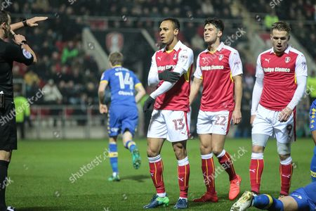 Stock Image of Peter Odemwingie (Rotherham United) speaks to the referee indicating that the collision with Liam Cooper (Leeds United) was accidental. The referee issues a straight red card and sends him off during the EFL Sky Bet Championship match between Rotherham United and Leeds United at the New York Stadium, Rotherham