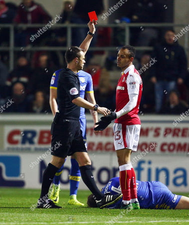 Stock Photo of Referee Mr Stuart Attwell shows Peter Odemwingie of Rotherham United a red card during the Sky Bet Championship match between Rotherham United and Leeds United played at the New York Stadium, Rotherham on 26th November 2016