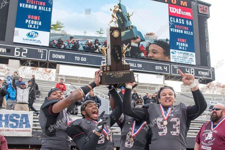 Stock Picture of Peoria players celebrate after defeating Vernon Hils 62-48 in the IHSA Class 5A high school championship football game, at Memorial Stadium in Champaign, Ill