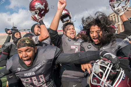 Stock Image of Peoria players celebrate after defeating Vernon Hills 62-48 in the IHSA Class 5A high school championship football game, at Memorial Stadium in Champaign, Ill