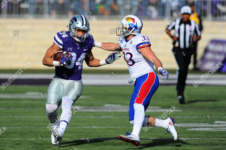 Kansas Jayhawks linebacker Keith Loneker Jr. (33) attempts to tackle Kansas State Wildcats running back Alex Barnes (34) who finished the game with 103 yds. on 10 carries and a touchdown during the NCAA Football game between the Kansas Jayhawks and the Kansas State Wildcats at Bill Snyder Family Stadium in Manhattan, Kansas