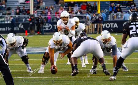 Stock Image of NCAA Football: Fiu Golden Panthers quarterback Christian Alexander (8) during the FIU Golden Panthers vs Old Dominion Monarchs game at SB Ballard Stadium in Norfolk, VA. Game is tied 14-14 at the half