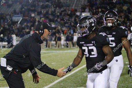 NCAA Football: Old Dominion Monarchs head coach Bobby Wilder congratulates Old Dominion Monarchs running back Ray Lawry (33) after scoring a touchdown during the FIU Golden Panthers vs Old Dominion Monarchs game at SB Ballard Stadium in Norfolk, VA. Old Dominion beat FIU 48-24