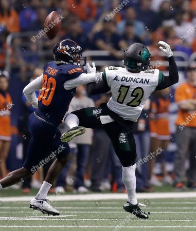 Alex Duncan, Josh Stewart Charlotte defensive back Alex Duncan (12) breaks up a pass intended for UTSA wide receiver Josh Stewart (80) during the first half of an NCAA college football game, in San Antonio