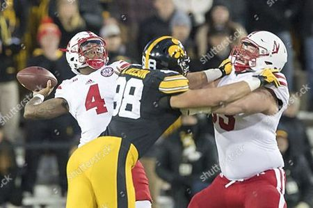 Lincoln, NE. U.S. - Nebraska Cornhuskers offensive lineman Tanner Farmer #63 battles Iowa Hawkeyes defensive end Anthony Nelson #98 as quarterback Tommy Armstrong Jr. #4 sets to release a pass down field in action during an NCAA Division 1 football game between #17 ranked Nebraska Cornhuskers and the Iowa Hawkeyes at Kinnick Stadium in Iowa City, IA..Attendance: 69,814.Iowa won 40-10