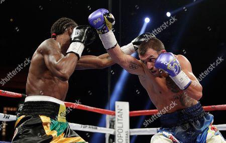 Vasyl Lomachenko, left, of Ukraine, fights Nicholas Walters, of Jamaica, in a WBO junior lightweight title boxing match, in Las Vegas