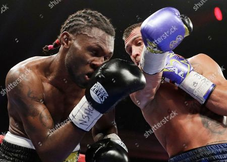 Vasyl Lomachenko, right, of Ukraine, fights Nicholas Walters, of Jamaica, in a WBO junior lightweight title boxing match, in Las Vegas