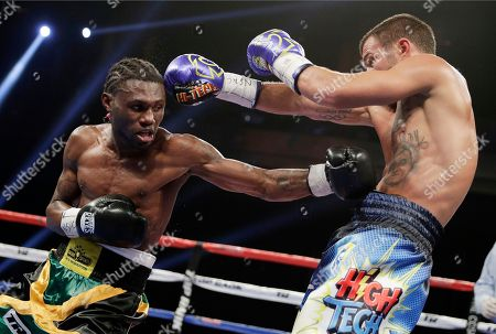 Vasyl Lomachenko, right, of Ukraine, dodges a punch by Nicholas Walters, of Jamaica, in a WBO junior lightweight title boxing match, in Las Vegas
