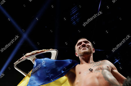 Vasyl Lomachenko, of Ukraine, celebrates after defeating Nicholas Walters, of Jamaica, in a WBO junior lightweight title boxing match, in Las Vegas