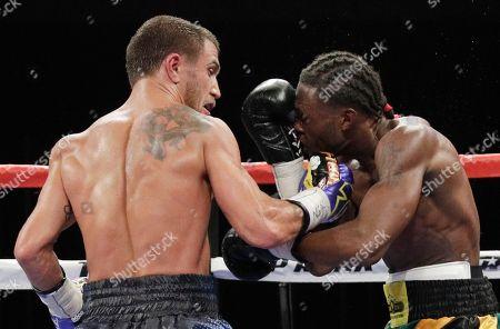 Vasyl Lomachenko, left, of Ukraine, hits Nicholas Walters, of Jamaica, in a WBO junior lightweight title boxing match, in Las Vegas