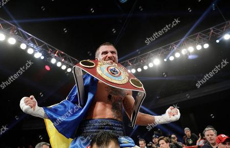 Stock Photo of Vasyl Lomachenko, of Ukraine, celebrates after defeating Nicholas Walters, of Jamaica, in a WBO junior lightweight title boxing match, in Las Vegas