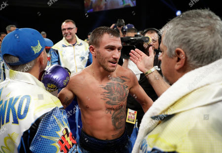 Stock Image of Vasyl Lomachenko, of Ukraine, celebrates after defeating Nicholas Walters, of Jamaica, in a WBO junior lightweight title boxing match, in Las Vegas