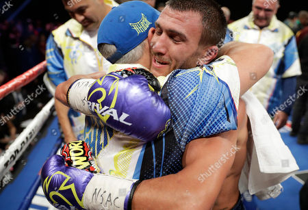 Stock Picture of Vasyl Lomachenko, of Ukraine, celebrates after defeating Nicholas Walters, of Jamaica, in a WBO junior lightweight title boxing match, in Las Vegas