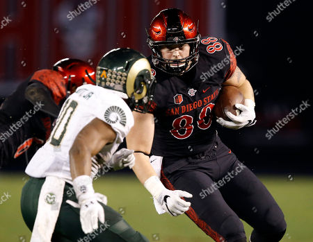 David Wells, Kevin Nutt Jr San Diego State tight end David Wells (88) runs away from Colorado State defensive back Kevin Nutt Jr. (10) during the first half of an NCAA football game in San Diego