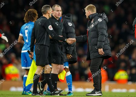 Bournemouth manager Eddie Howe shakes hands with linesman Adrian Holmes who didn't see a blatant hand ball by Nacho Monreal of Arsenal during the Premier League match between Arsenal and AFC Bournemouth played at The Emirates Stadium, London on 27th November 2016