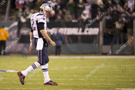 New England Patriots quarterback Tom Brady (12) hangs his head as he heads back to the sidelines during the NFL game between the New England Patriots and the New York Jets at MetLife Stadium in East Rutherford, New Jersey. The New England Patriots won 22-17