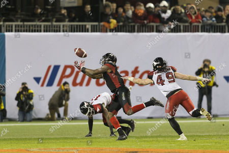 Ottawa Redblacks wide receiver Ernest Jackson (9) catches the game winning touchdown in overtime. Calgary Stampeders Alex Singleton (49) and Joshua Bell (11) defend during the 104th edition of the Grey Cup, the championship game between Calgary Stampeders and Ottawa Redblacks at BMO Field in Toronto, Ontario, Canada. Ottawa Redblacks won the Grey Cup in overtime by a score of 39-33, bringing the Cup to Ottawa for the first time in 40 years