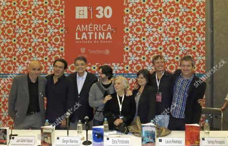 Latin American authors, from left, Argentina's Eduardo Sacheri, Colombia's Juan Gabriel Vasquez, Nicaragua's Sergio Ramirez, Argentina's Andres Neuman, Mexico's Elena Poniatowska, Colombia's Laura Restrepo, Mexico's Xavier Velasco and Peru's Santiago Roncagliolo pose for a portrait after a group lecture at the Guadalajara International Book Fair, in Guadalajara, México. The authors are winners of the Alfaguara Prize and spoke about the meaning of Latin America