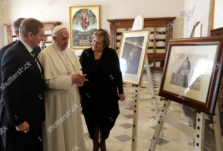 Pope Francis exchanges gifts with Irish Prime Minister Enda Kenny, left, and his wife Fionnuala during a private audience in his studio, at the Vatican