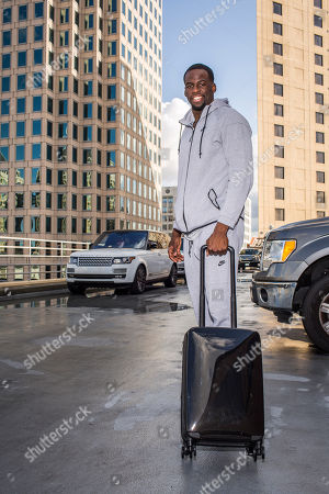 Draymond Green Draymond Green rolling with Raden smart luggage, in Oakland, Calif