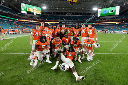 Seniors Gage Batten #40, Hunter Knighton #54, Austin Pfenninger #35, Adrian Colbert #25, Marquez Williams #36, Michael Welch #20, Alex Gall #67, Danny Isidora #63, Rayshawn Jenkins #26, Justin Vogel #16, Frank Gabriel #55, Standish Dobard #5, Corn Elder #29, Stacy Coley #3, Malcolm Lewis #9, Kevin Carroll #30, and Jamal Carter, Sr. #6 of Miami pose with head coach Mark Richt for a group photo after the NCAA football game between the Miami Hurricanes and the Duke Blue Devils in Miami Gardens, Florida. The Hurricanes defeated the Blue Devils 40-21