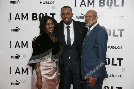 Usain Bolt, centre, poses with his father Wellesley Bolt, right, and mother Jennifer Bolt