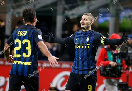 Inter Milan's Mauro Icardi, right, celebrates with his teammate Citadin Martins Eder after scoring during the Serie A soccer match between Inter Milan and Fiorentina at the San Siro stadium in Milan, Italy