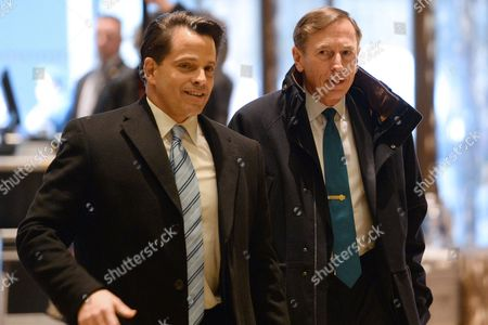 General David Petraeus (r), Former Director of the Central Intelligence Agency, is seen arriving in the lobby of the Trump Tower in New York, New York,.
