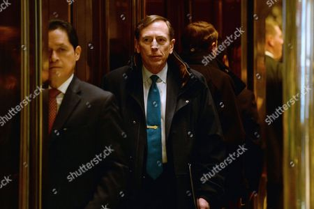 General David Petraeus, Former Director of the Central Intelligence Agency, is seen inside the elevator after entering the lobby of the Trump Tower in New York, New York,.