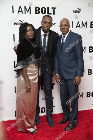 Usain Bolt with parents Jennifer Bolt and Wellesley Bolt