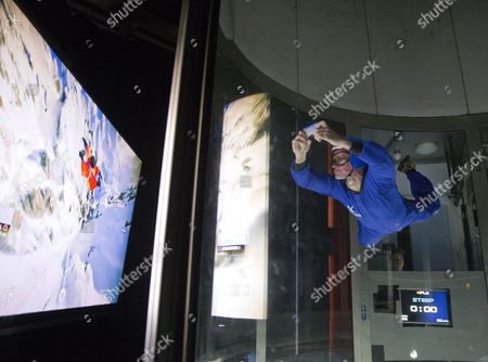 Eddie Edwards playing a videogame in a vertical wind tunnel