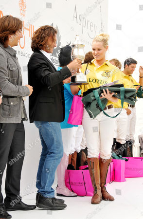 Asprey World Class Polo at Hurtwood Park Polo and Country Club Ewhurst Green Surrey the Prize Giving Manuele Malenotti and Michele Malenotti of Belstar Present Amy Guy of Lotus Team with the Celebrity Team Winners Cup