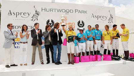 Asprey World Class Polo at Hurtwood Park Polo and Country Club Ewhurst Green Surrey the Prize Giving Manuele Malenotti and Michele Malenotti of Belstar Katie Price and Kenney Jones Glen Gilmore and Peter Woods (mahiki Rum Team) and in Yellow the Winners the Lotus Team with Amy Guy