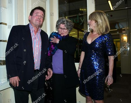 Stock Picture of Book Launch Party For Diary of the Lady at the Lady Magazine Office Bedford Street Covent Garden London Ben & Julia Budworth with the Lady Editor and Author of the Book Rachel Johnson