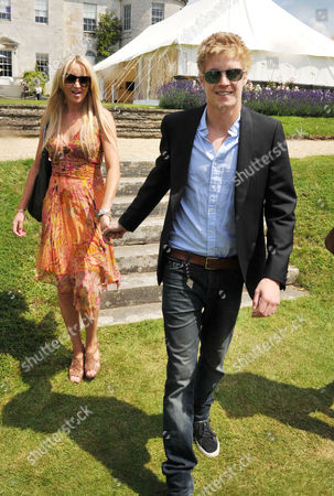 Cartier Style Et Luxe On the Lawn of Goodwood House During the Festival of Speed Rufus Tiger Taylor with His Girlfriend  Kimberley Pody