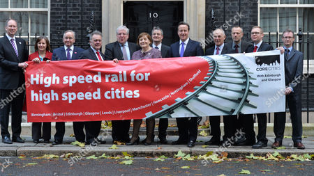 Stock Image of High Speed Rail For High Speed Cities Photocall Outside Number 10 Downing Street - A Declaration of Support For Hs2 From Leaders and Representatives of the Uk's Ten Largest Cities Outside of London Ged Fitzgerald (liverpool) Julie Dore (sheffield) Gordon Matheson(glasgow) Sir Albert Bore (birmingham) Patrick Mcloughlin Mp Helen Holland (bristol) James Lewis (leeds) David Cameron Sir Richard Leese (manchester) Jon Collins (nottingham) Nick Forbes (newcastle)