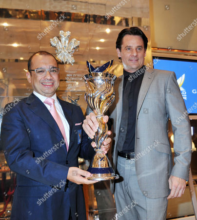 Stock Picture of Launch of the New Isaf World Match Race Tour Championship Trophy at GarrardÂ' Flagship Store Albemarle Street Datuk Patrick Lim World Match Racing Tour Executive Chairman and Eric Deardorff Garrard Ceo