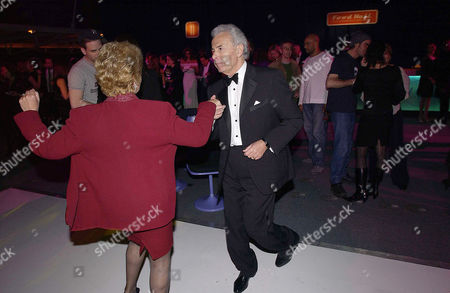 Stock Photo of Party at Old Billingsgate Market Following A Benefit Performance to Raise Funds For the Old Vic Theatre Lord Michael and Lady Gilda Levy