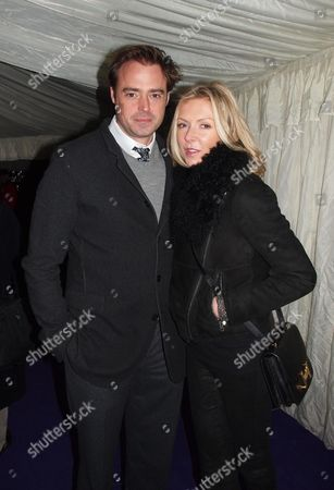 Stock Picture of St Paul's Knightsbridge Carol Service at St Paul's Church Knightsbridge London Jamie Theakston and His Wife Sophie Siegle