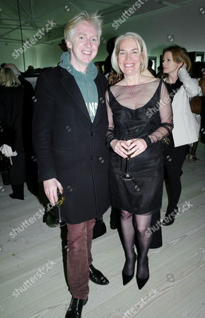 Sunday Times Magazine 50th Anniversary Exhibition Private View at the Saatchi Gallery Philip Treacy and the Magazine Editor Sarah Baxter