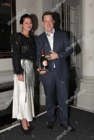 The Tatler Restaurant Awards 2011 at the Langham Hotel Portland Place London Restaurant of the Year Ashley Palmer-watts of Dinner by Heston Blumenthal with Josephine Stead General Manager of Dinner