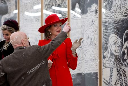 Belgium's Queen Mathilde, right, and Netherlands' Queen Maxima, left, listen to an explanation by artist Pierre Alechinsky at the Cobra Museum in Amstelveen, near Amsterdam