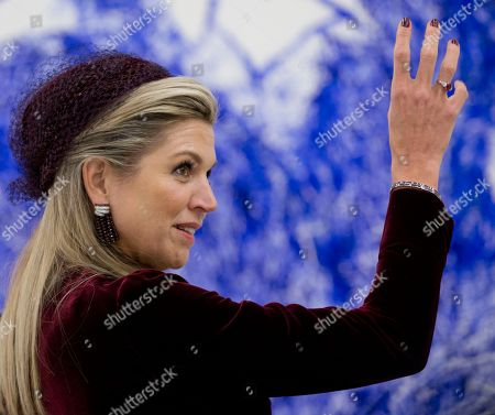 Netherlands' Queen Maxima listens to an explanation by artist Pierre Alechinsky at the Cobra Museum in Amstelveen, near Amsterdam
