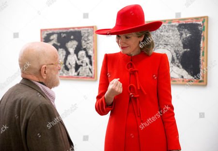 Belgium's Queen Mathilde listens to an explanation by artist Pierre Alechinsky at the Cobra Museum in Amstelveen, near Amsterdam