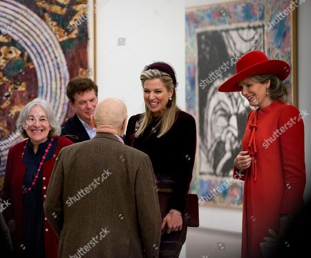 Belgium's Queen Mathilde, right, and Netherlands' Queen Maxima, center, listen to an explanation by artist Pierre Alechinsky, third from left, at the Cobra Museum in Amstelveen, near Amsterdam