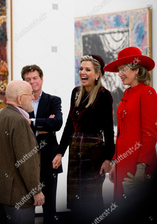 Belgium's Queen Mathilde, right, and Netherlands' Queen Maxima, second right, listen to an explanation by artist Pierre Alechinsky, left, at the Cobra Museum in Amstelveen, near Amsterdam
