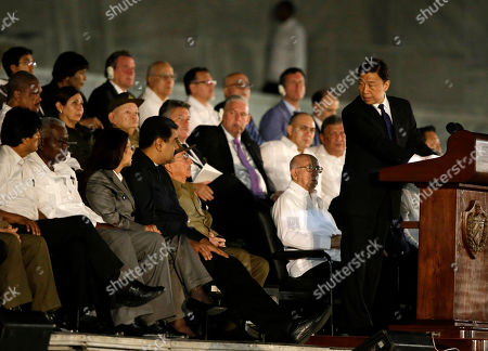 Stock Photo of China's Vice-President Li Yuanchao, right, speaks during a rally honoring Fidel Castro at the Revolution Plaza in Havana, Cuba, . Regional leaders and tens of thousands of Cubans filled Havana's Plaza of the Revolution Tuesday night for a service honoring Fidel Castro on the wide plaza where the Cuban leader delivered fiery speeches to mammoth crowds in the years after he seized power